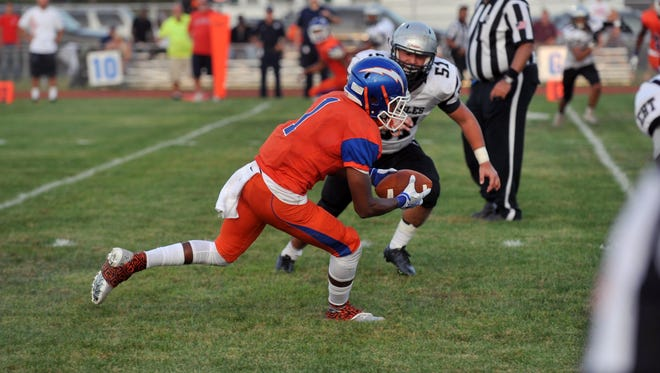 Millville's Carlton Lawrence (1) gets a receiving touchdown in the second quarter against Egg Harbor Township Friday, Sep. 9, 2016 in Millville.