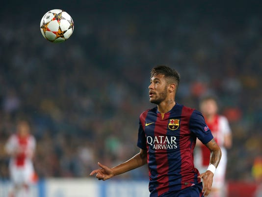 Barcelona's Neymar looks at the ball during the Champions League group F soccer match between F.C. Barcelona and Ajax at Camp Nou stadium in Barcelona, Spain, Tuesday, Oct. 21, 2014. Barcelona defeated Ajax 3-1. (AP Photo/Emilio Morenatti)
