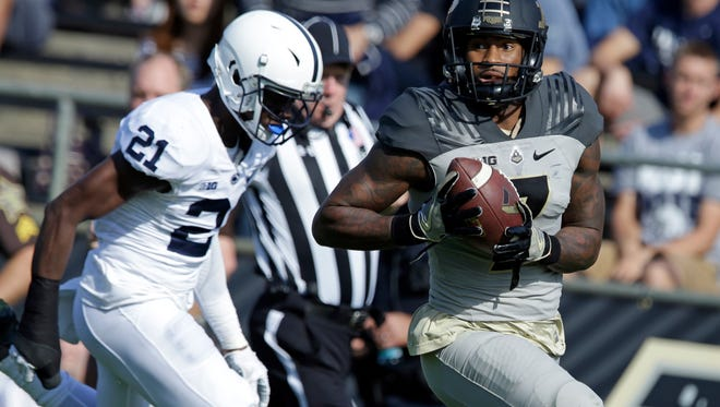 Purdue wide receiver DeAngelo Yancey (7) scores on a 62-yard pass in front of Penn State cornerback Amani Oruwariye (21) during the second half of an NCAA college football game in West Lafayette, Ind., Saturday, Oct. 29, 2016. Penn State defeated Purdue 62-24. (AP Photo/Michael Conroy)