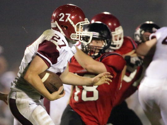 De Pere's Mason Kirby (27) carries the ball against Sheboygan South.