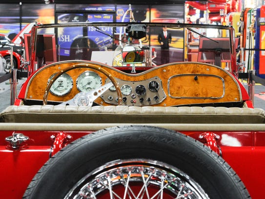 The varnished wood dash board stands out on the 1953