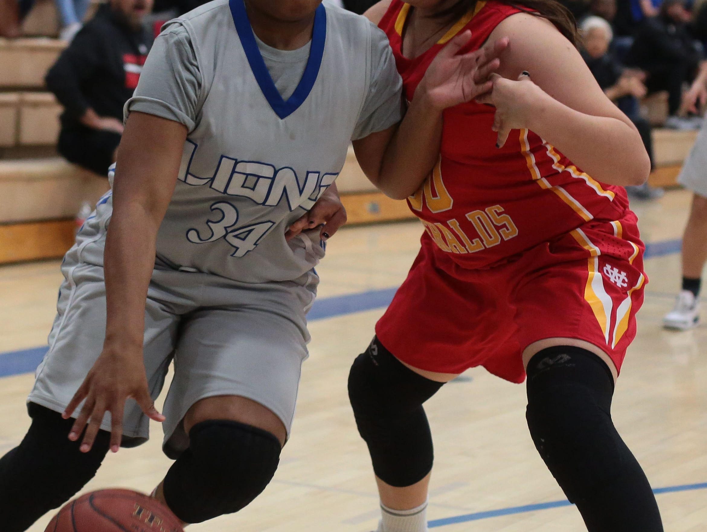 Cathedral City's Dejah Lord moves pass Whittier Christian defenders on Saturday, February 18, 2017 in Cathedral City.