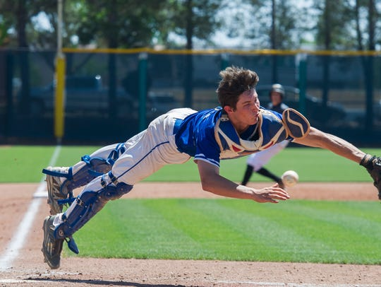 Dixie High School catcher Chase Lundin dives for a