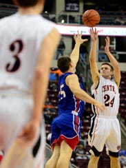 Central York's Jared Wagner shoots over Jonathan Sager