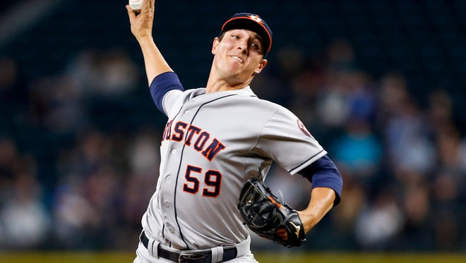 Apr 20, 2015; Seattle, WA, USA; Houston Astros pitcher Asher Wojciechowski (59) throws against the Seattle Mariners during the fourth inning at Safeco Field. Mandatory Credit: Joe Nicholson-USA TODAY Sports