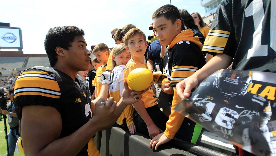 Jay Scheel signs autographs before the Hawkeyes' spring