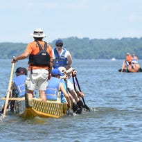 Steve Hendrickson of Poughkeepsie mans the drum for the 'Tubby's Conquistadors' boat during Saturday's Dragon Boat Race & Festival on the Hudson River.