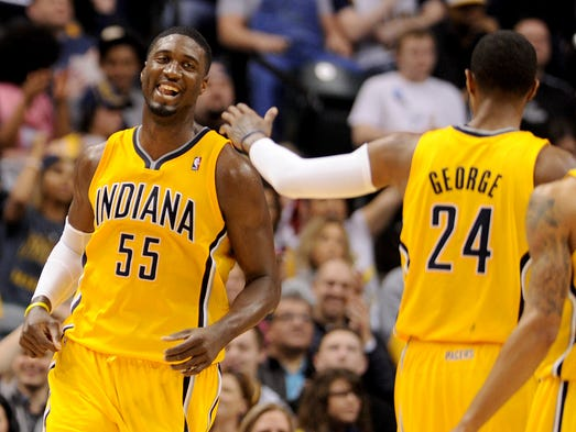Indiana Pacers center Roy Hibbert celebrates a three-point play opportunity against the Brooklyn Nets inside Bankers Life Fieldhouse, Saturday, February 1, 2014, in Indianapolis.