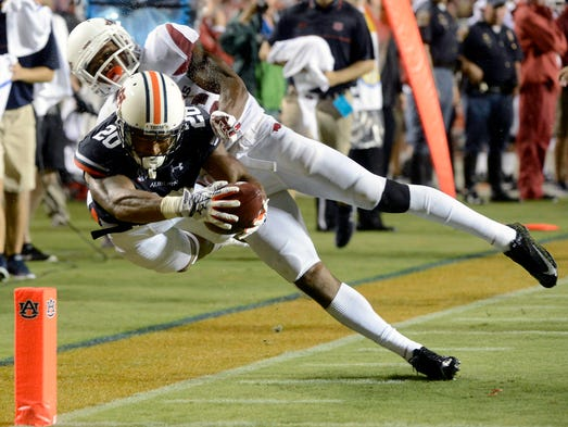 Arkansas safety Rohan Gaines knocks Auburn running back Corey Grant out of bounds just short of the goal line at Jordan-Hare Stadium in Auburn, Ala., Saturday.