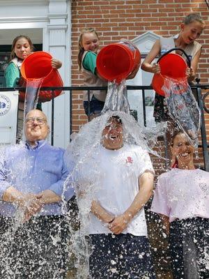 Pelham Town Supervisor Peter DiPaola, Westchester County Legislator Jim Maisano and state Assemblywoman Amy Paulin take the Ice Bucket Challenge on July 25, 2014,  outside Pelham Town Hall.