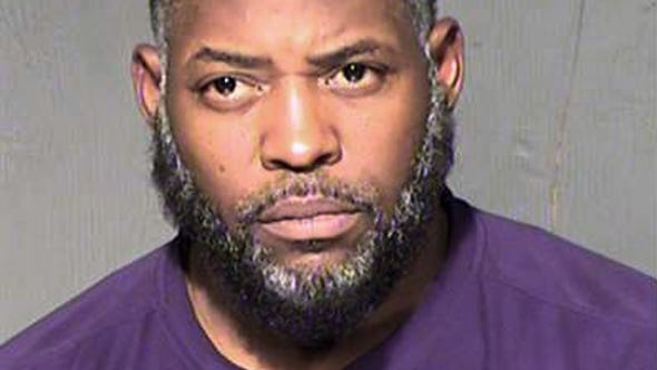 FILE - This undated file booking photo from the Maricopa County, Ariz., Sheriff's Department shows Abdul Malik Abdul Kareem. The Arizona man is set for trial Tuesday, Feb. 16, 2016, on terror charges linked to Islamic State. Kareem is accused of providing the guns used in an attack at a Prophet Muhammad cartoon contest in Texas. (Maricopa County Sheriff's Department via AP, File)