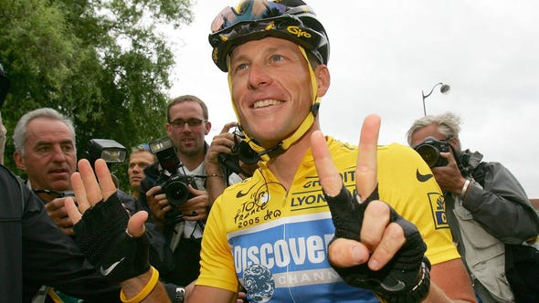 This July 24, 2005 file photo shows overall leader Lance Armstrong signaling seven for his seventh straight win in the Tour de France cycling race, at the start of the 21st and final stage of the race between Corbeil-Essonne.