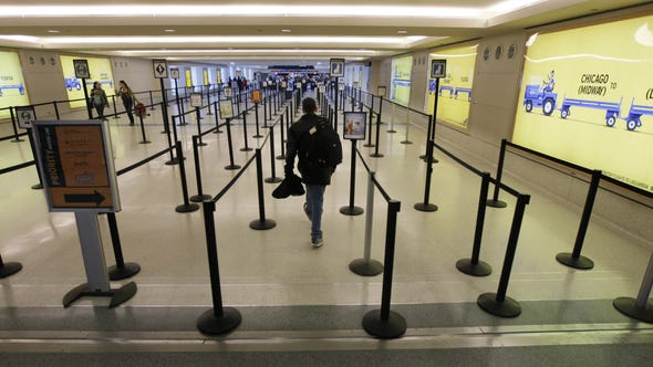 Security lines at Midway International Airport that are normally bustling stand nearly abandoned, Feb. 1, 2011, in Chicago.