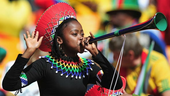 A South African fan blows a vuvuzela at the 2010 World Cup opening ceremony. The horns return on an international stage this month for the African Cup of Nations.
