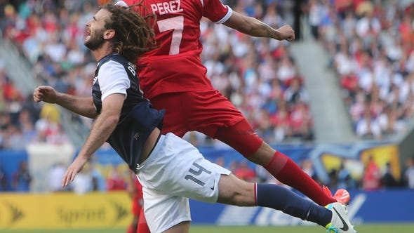 USA player Kyle Beckerman goes up for a header with Panama player Blas Perez during the 2013 Gold Cup championship game at Soldier Field.