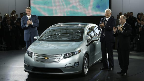 Then General Motors CEO Rick Wagoner, from left, Vice Chairman, Bob Lutz, and President and COO Fritz Henderson stand with the Chevrolet Volt as it is unveiled in 2008.