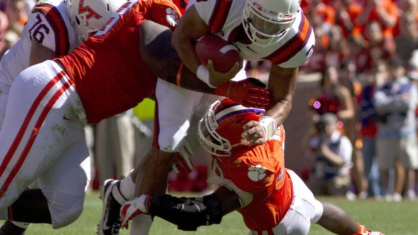 Virginia Tech quarterback Logan Thomas is brought down during the second quarter of a game against Clemson.