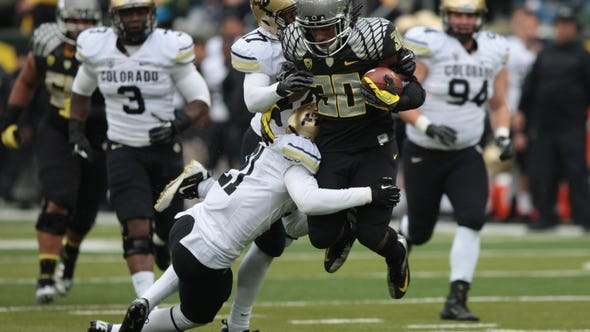 Oregon running back Ayele Ford carries the ball against Colorado on Oct. 27.