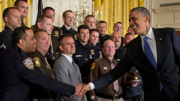 President Obama shakes hands with New York City Police Detective Ivan Marcano