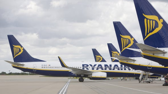 A Ryanair  airplane taxis back from the terminal at Stansted airport in Stansted, U.K. The airport was temporarily closed this morning due to snow.