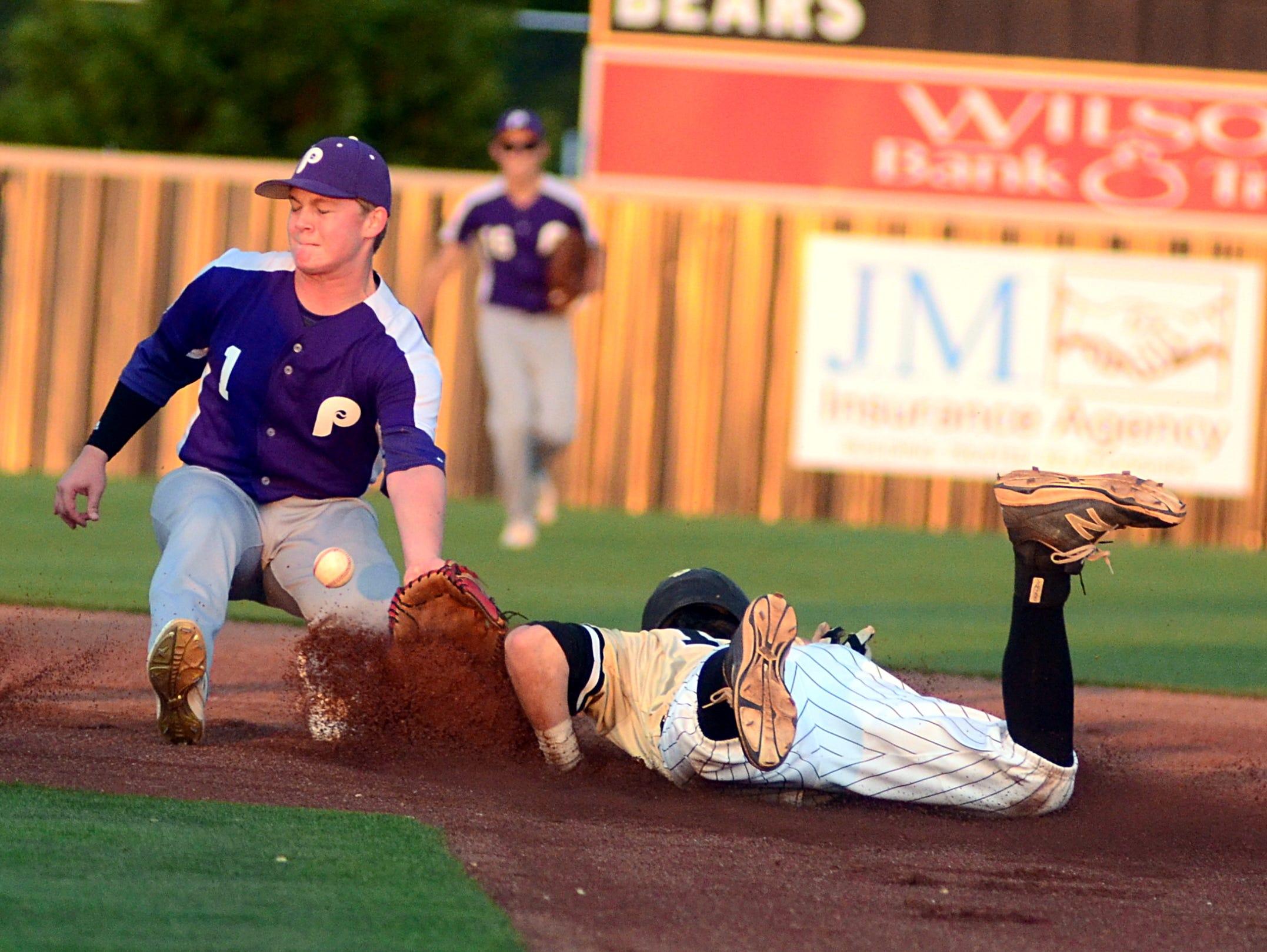 Portland High freshman shortstop Brandon Tucker receives a throw as Mt. Juliet junior Aaron Brown steals second base during first-inning action.