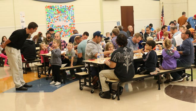 Many local fathers joined their child at Bataan Memorial Primary on Tuesday evening for both free pizza and a chance to learn about more ways to become involved at the school.