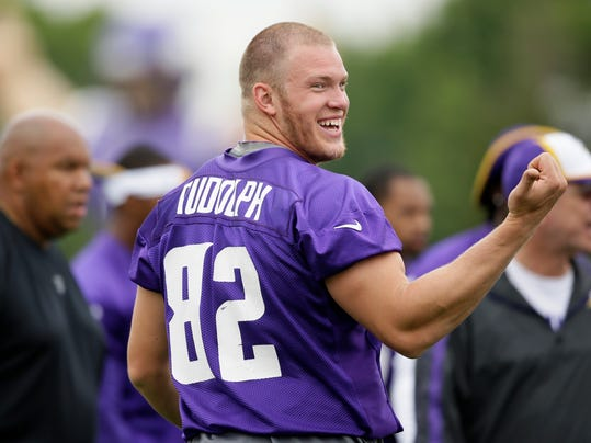 Minnesota Vikings tight end Kyle Rudolph laughs with teammates during NFL football training camp, Monday, July 28, 2014, in Mankato, Minn. (AP Photo/Charlie Neibergall)