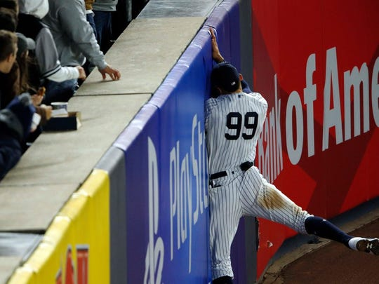 Aaron Judge makes a catch against the wall in fourth inning of Game 3 of the ALCS between the Yankees and Astros at Yankee Stadium.