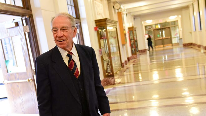 U.S. Senator Chuck Grassley smiles as he stands in the hallway on Monday, November 23, 2015, during a visit to East High School.