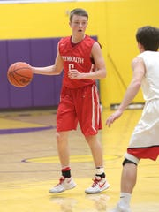 Plymouth's Walker Elliott looks for an opening while playing in sectionals at Lexington High School on Tuesday.
