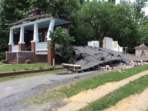 Four workers escaped from a house that collapsed in