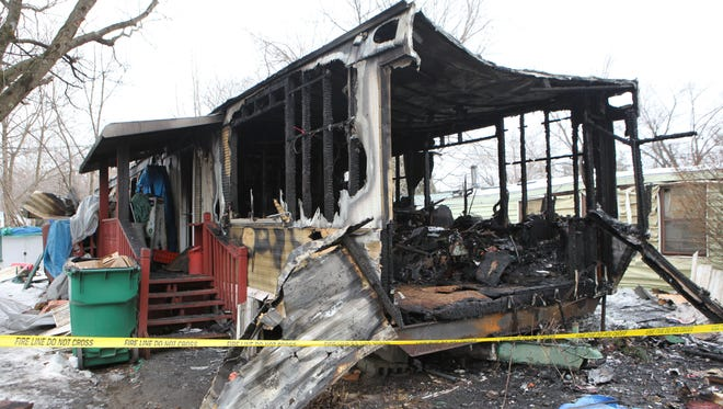The charred remains of a trailer located in the Town of Poughkeepsie, which caught fire on Sunday night.