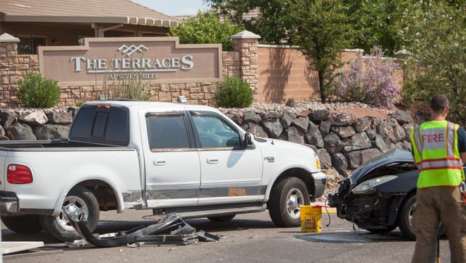 A sedan and a pickup truck collide on Tuweap sending a woman and her child to the hospital Friday, Aug. 21, 2015.