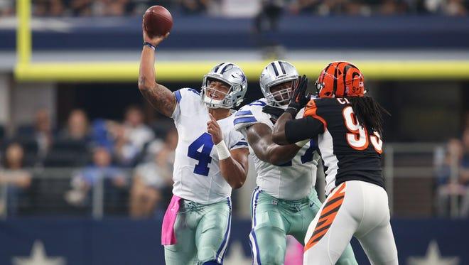 Dallas Cowboys quarterback Dak Prescott (4) throws the ball against Cincinnati Bengals at AT&T Stadium.