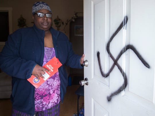 Shemeka Mitchell-Hickman found a swastika painted on her front door and her car windshield smashed on Sunday.