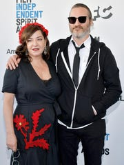 Lynne Ramsay and Joaquin Phoenix attend the 2019 Film Independent Spirit Awards.