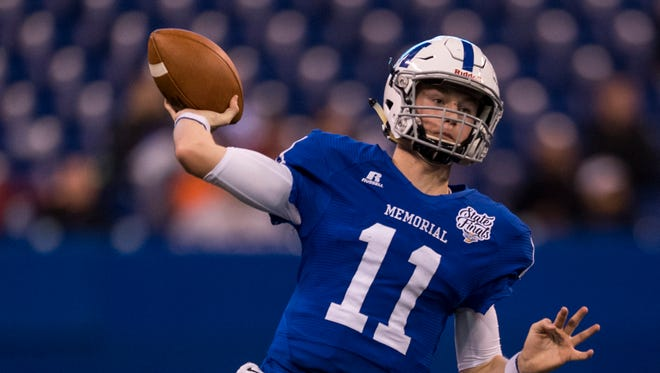 Michael Lindauer (11) throws a pass in Memorial's 29-17 victory over Indianapolis Brebeuf Jesuit in the Class 3A state championship game at Lucas Oil Stadium in Indianapolis. He was named C&P All-Metro Co-Player of the Year with Central's Tor'Jon Evans