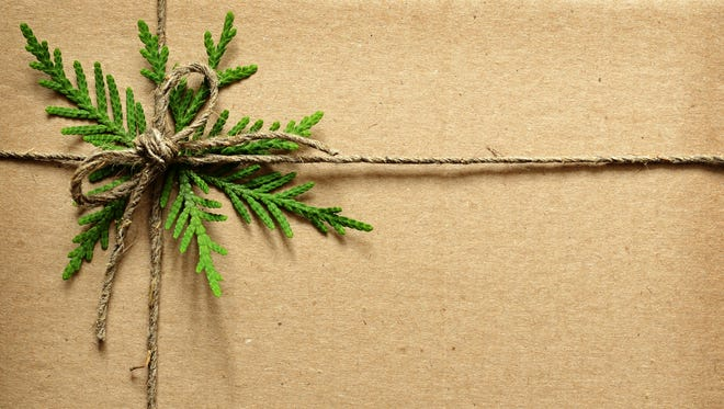 """Classy, simple, and """"green."""" A simple cardboard box wrapped with twine and a few greens to add sparkle."""