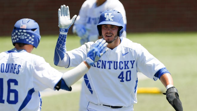 Zach Reks of the Kentucky Wildcats high fives Troy Squires after scoring in the first inning against the Ohio Bobcats during the NCAA Baseball Regional at Cliff Hagan Stadium in Lexington, Kentucky on Friday June 2, 2017. (Michael Reaves/Special to The Courier Journal)