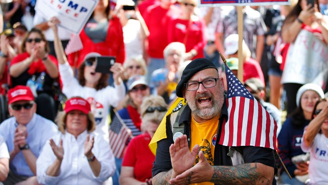 Ron White, of South Carolina, attends a pro-President Donald Trump rally at the state Capitol in Phoenix on March 4, 2017.