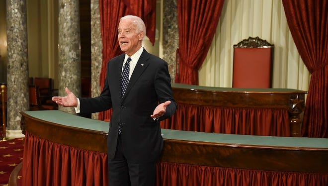Vice President Joe Biden welcomes the next senator into the Old Senate Chamber during a mock swearing in ceremony on Capitol Hill in Washington, Tuesday, Jan. 3, 2017, as the 115th Congress begins. (AP Photo/Kevin Wolf)
