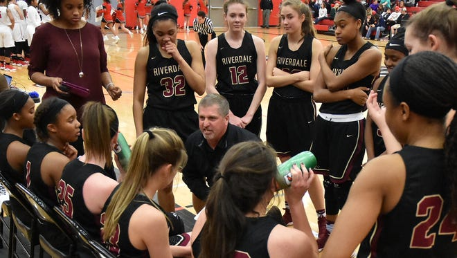 Riverdale coach Randy Coffman talks to his squad during Friday's win at Stewarts Creek. The Lady Warriors will play in the Nike Tournament of Champions in Phoenix this week.