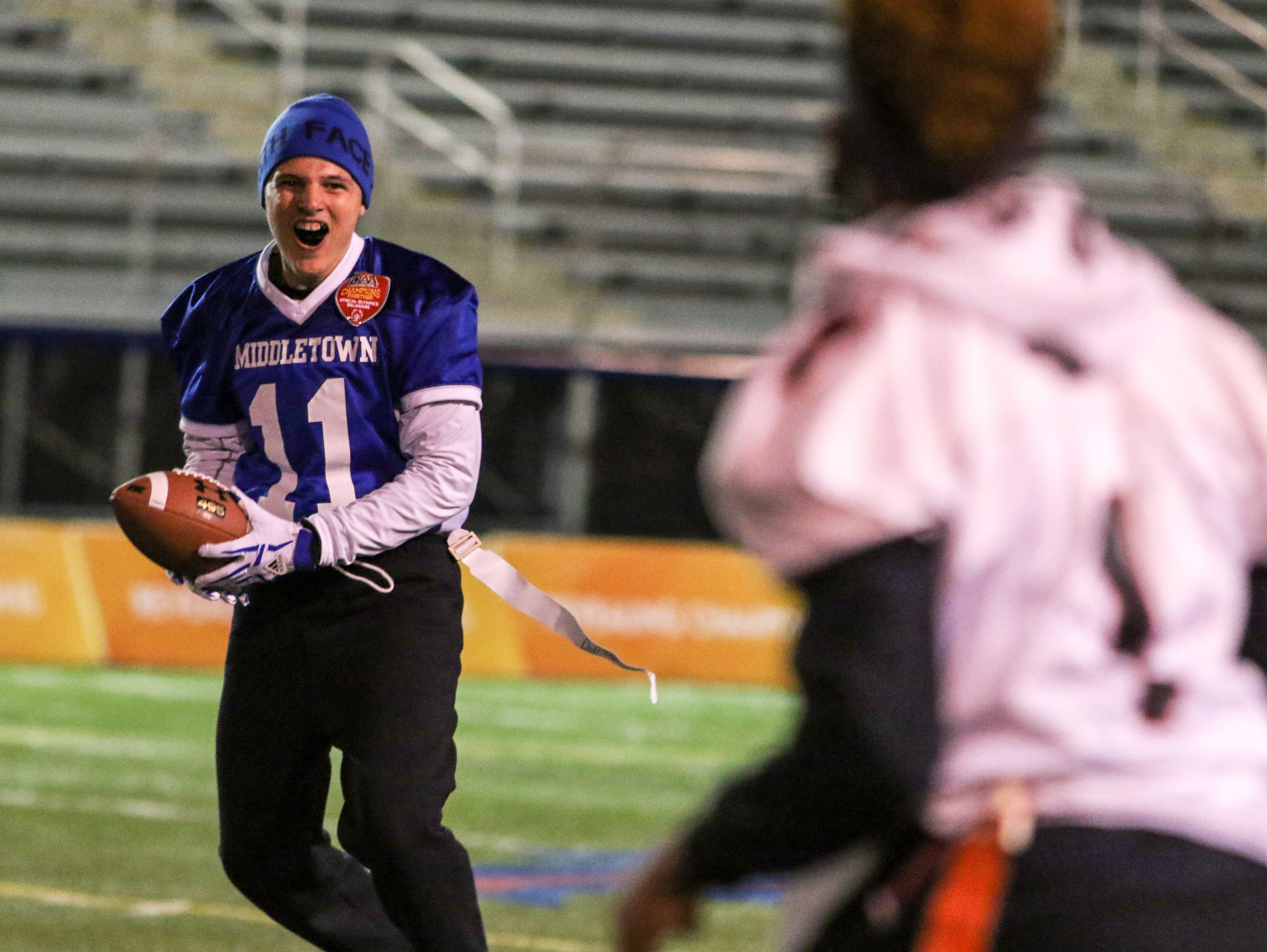 Middletown athlete Dalton Johnson celebrates a touchdown run.