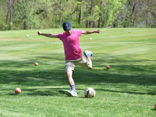 Anthony Germano, 15, of LaGrange, demonstrates footgolf
