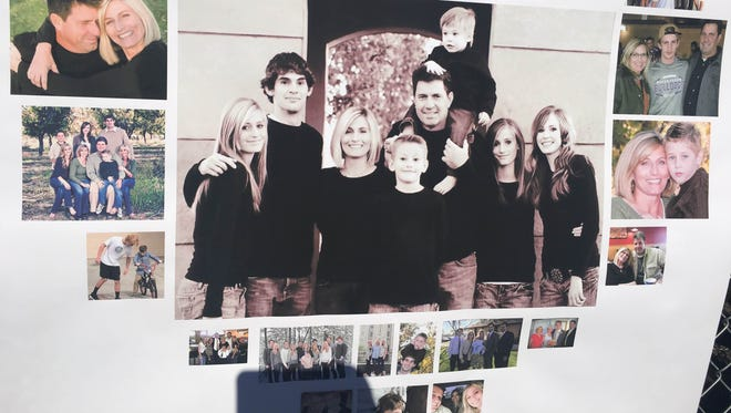 Photos of the Arnett family are posted at a fundraiser held at Queen Creek High School on Jan. 28, 2017.