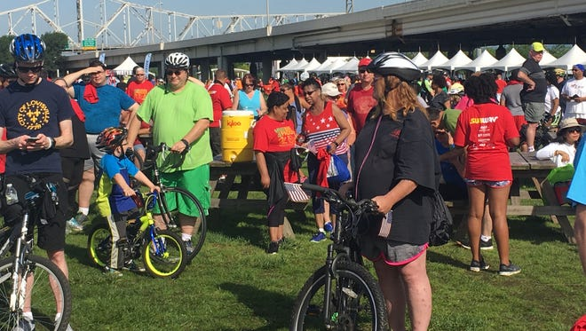 A crowd gathers at Waterfront Park for the Hike, Bike and Paddle for the 13th year.