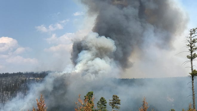 The Ditch Creek fire spews smoke in the Helena-Lewis and Clark National Forest.