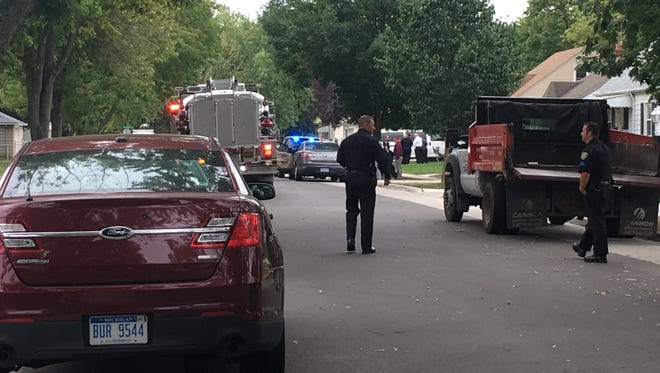 Dearborn police and fire officials at the scene of a shooting at a home in Dearborn.