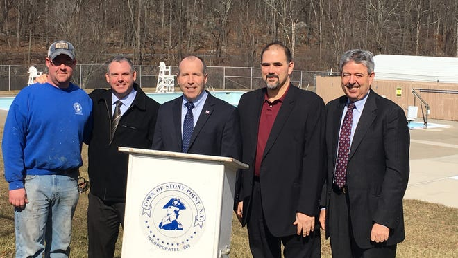 From left to right, Stony Point Parks and Grounds employee Curtis Wicks, Councilman Mike Puccio, Supervisor Jim Monaghan, Suez Vice President Chris Graziano and Suez spokesman Bill Madden at the Stony Point town pool.