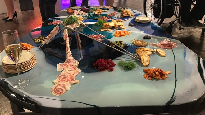 Hors d'oeuvres are draped over the art at Art Dish at the Harrison Center on Feb. 19, 2018.
